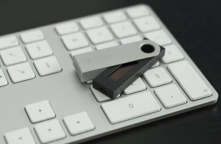 Ledger Nano S (partially closed) on a keyboard