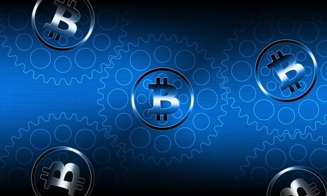 Bitcoin (BTC) logo on a blue background (with cogs)